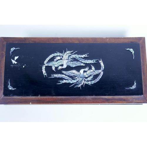 27 - A Japanese lacquered wood glove box, the cover with phoenix and bats, and mother of pearl, 10½