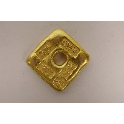 49 - A Chinese gilt metal trade token, 2