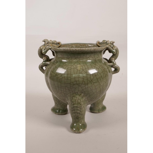 55 - A Chinese green crackle glazed porcelain censer on tripod feet with two dragon handles, 6