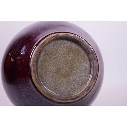 28 - A Chinese flambé glazed pottery vase, 13½