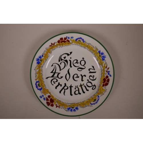 3 - A Russian style porcelain cabinet plate bearing the propaganda slogan 'Sieg der Werktatigen' (victor...