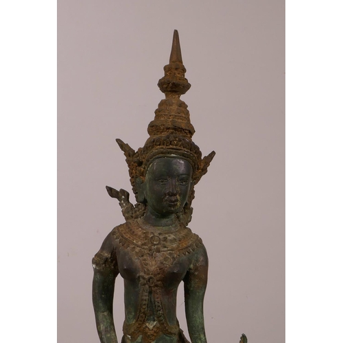 34 - A Thai bronze of a dancing woman, with verdigris patina, 16