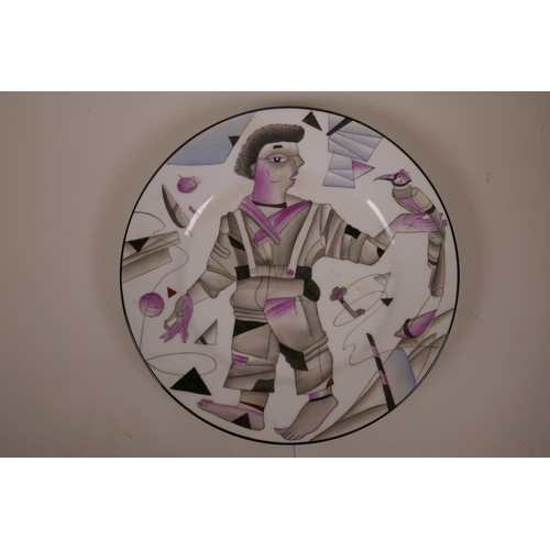 36 - A Russian style porcelain cabinet plate decorated with a constructivist style figure, mark to base, ...