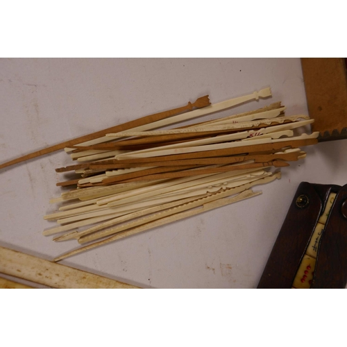 41 - A quantity of Chinese dyed bone gaming chips together with a box of bone and wood gaming sticks, a l...