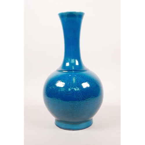 43 - A Chinese porcelain vase with a teal crackle glaze and incised decoration of a dragon chasing the fl...