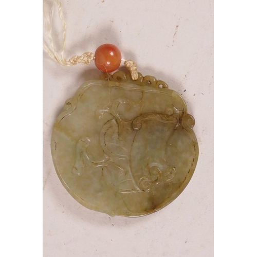 44 - An antique Chinese green/grey jade pendant with carved decoration, 2