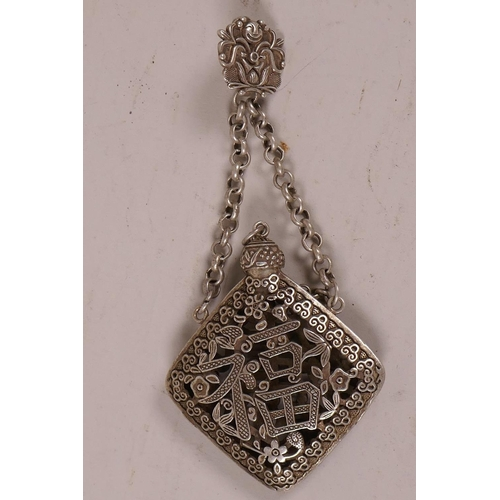 49 - A Chinese white metal incense holder of pierced form on chain and belt clip, marked with calligraphy...