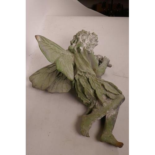 51 - A cast metal garden figurine of a sleeping fairy, 16½