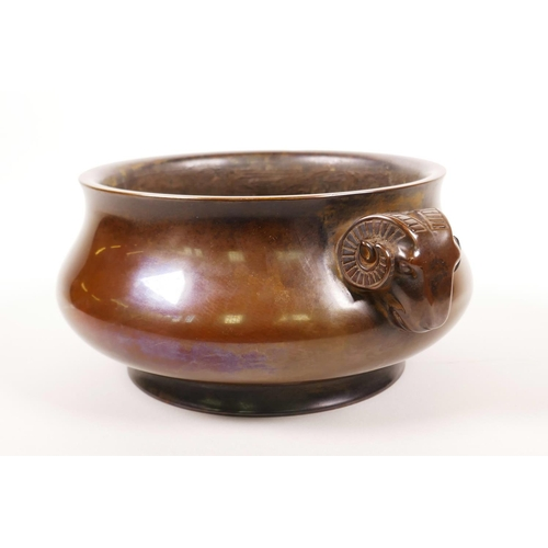 53 - A Chinese patinated bronze censer with two ram's mask handles, impressed 16 character mark to base, ...