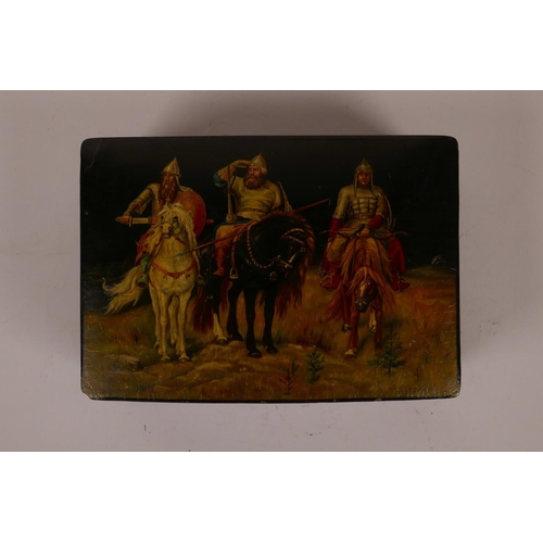 54 - A Russian black lacquer trinket box with hand painted decoration of three C16th cavalrymen, signed i...
