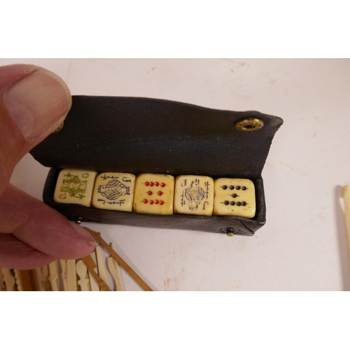 34 - A quantity of Chinese dyed bone gaming chips together with a box of bone and wood gaming sticks, a l...