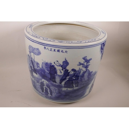 16 - A large Chinese blue and white porcelain jardiniere decorated with figures in a landscape, 7 charact...