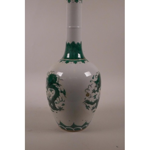 23 - A Chinese famille verte porcelain bottle vase decorated with a dragon chasing a gilt flaming pearl, ...
