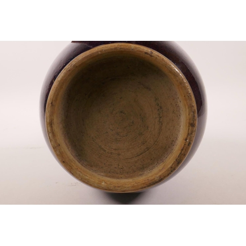 25 - A Chinese flambé glazed pottery vase, 13