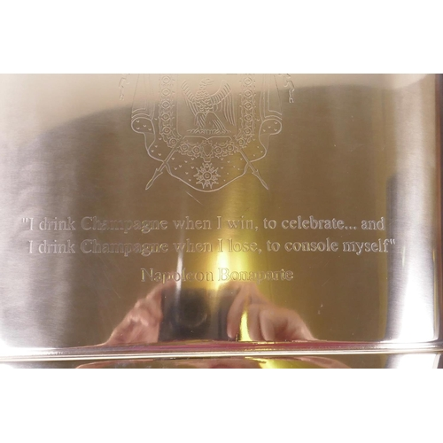 29 - A chrome plated metal champagne cooler engraved with quotations from Lily Bollinger and Napoleon Bon...