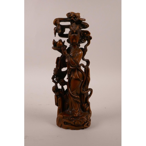 30 - A Chinese boxwood carving of Quan Yin holding a platter of fruit, 9