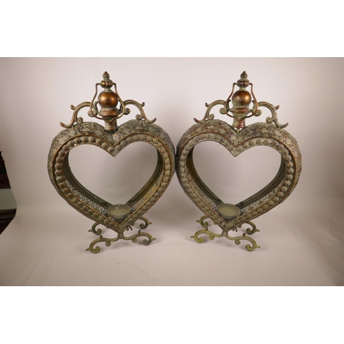 32 - A pair of decorative heart shaped candle lanterns with pierced bodies, 21