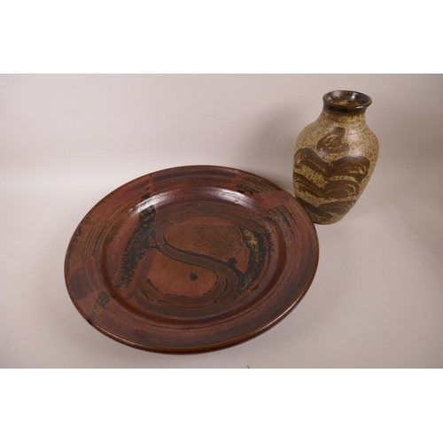 36 - A studio pottery charger with high fired brown glaze, impressed mark CF to base, 15½