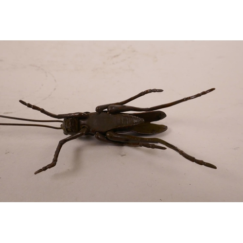 39 - A Japanese style Jizai cricket with articulated legs, antennae and wings, 5½
