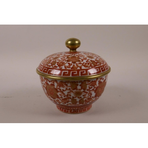 40 - A Chinese red and white porcelain box and cover, with scrolling floral decoration and gilt highlight...