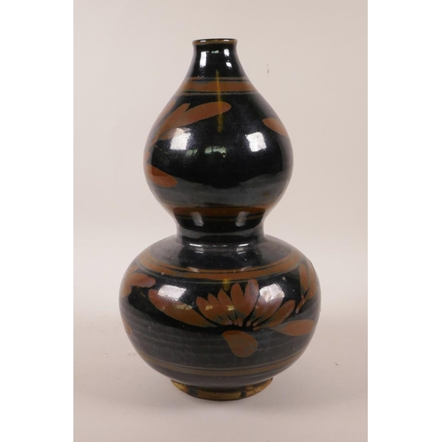45 - A Chinese Cizhou kiln double gourd vase with floral decoration, 10½