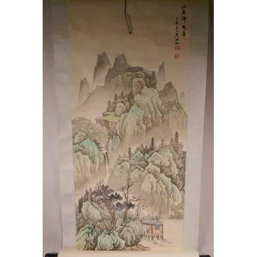 46 - A Chinese watercolour scroll depicting a mountain landscape, 15½