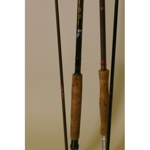 47 - A Shakespeare O-Series graphite class two piece fly rod and another fly fishing reel...