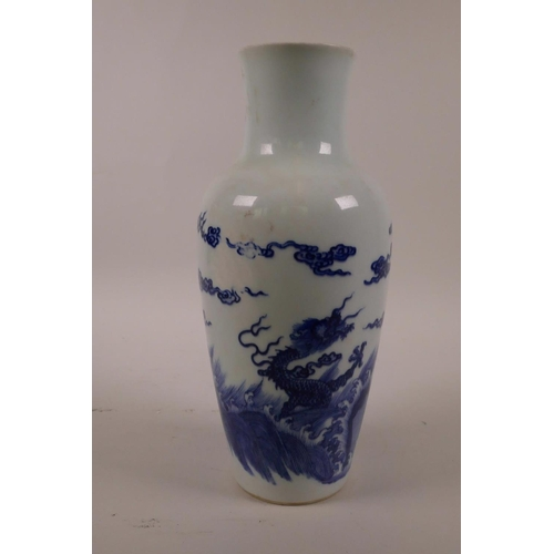 48 - A Chinese blue and white porcelain vase decorated with dragons above a stormy sea, 6 character mark ...