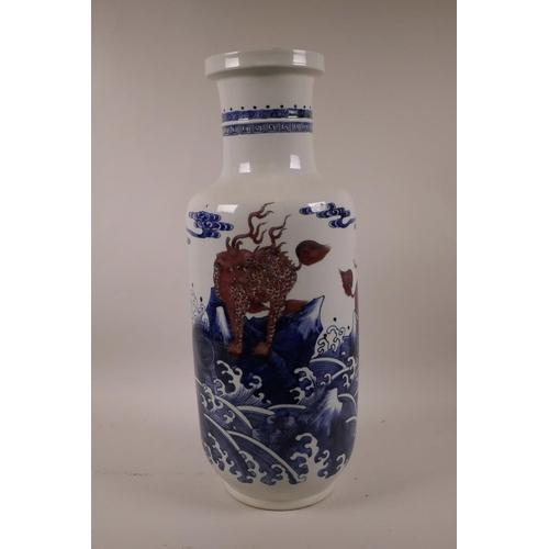 5 - A Chinese blue and white porcelain Rouleau vase decorated with mythical creatures in red, 17½