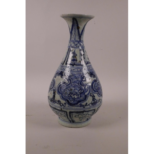 50 - A Chinese blue and white pottery pear shaped vase with archaic style decoration, 10