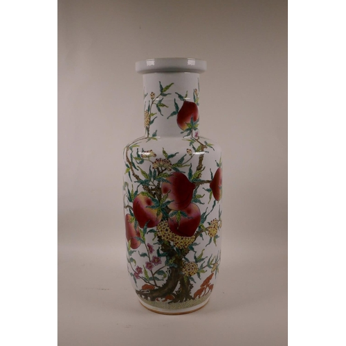 55 - A Chinese polychrome Rouleau vase with enamel decoration of a fruit laden peach tree, 17½