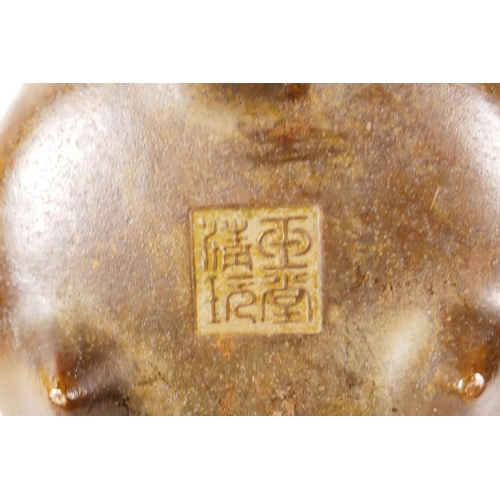 13 - A small Chinese bronze censer with two phoenix eye handles on tripod supports, impressed seal mark t...