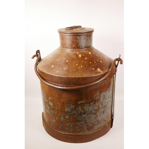 19 - A metal milk churn with iron swing handle, 20