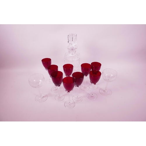 2 - A set of nine ruby wine glasses with clear twist stems, 5¾