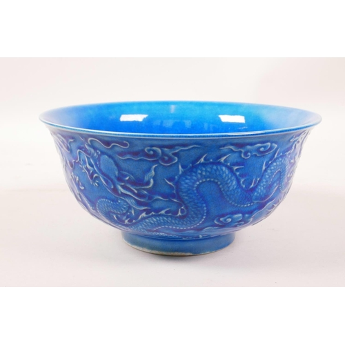 3 - A Chinese blue glazed porcelain rice bowl with underglaze dragon decoration, 6 character mark to bas...