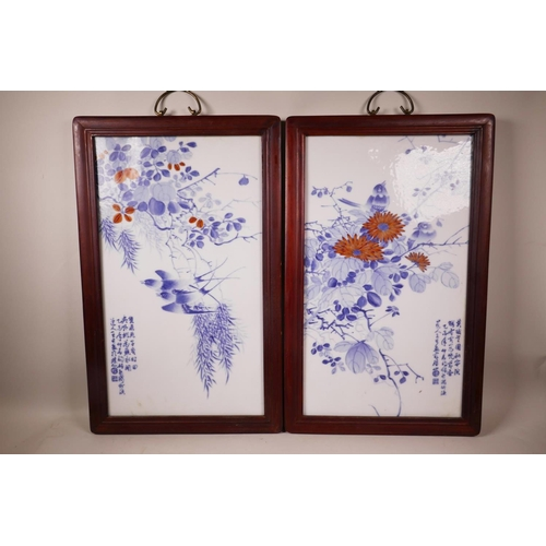 36 - A pair of Chinese blue and white porcelain panels decorated with birds amongst branches in bloom wit...