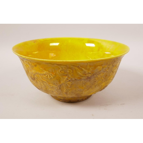 38 - A yellow ground porcelain bowl with raised dragon decoration, 6 character mark to base, 6½
