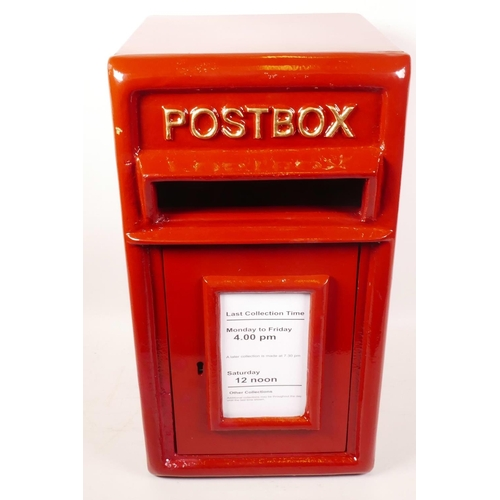 4 - A metal postbox with cast iron front panel and door, 17½