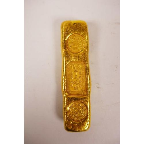 40 - A Chinese gilt white metal trade token/ingot, 4
