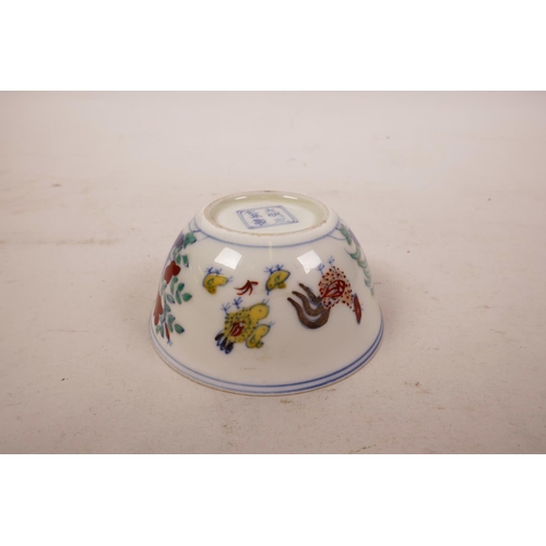 46 - A Chinese doucai porcelain tea bowl with chicken decoration, 6 character mark to base, 3½