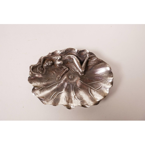 48 - A Chinese white metal trinket dish in the form of a lily pad with a sleeping female nude, 4 characte...