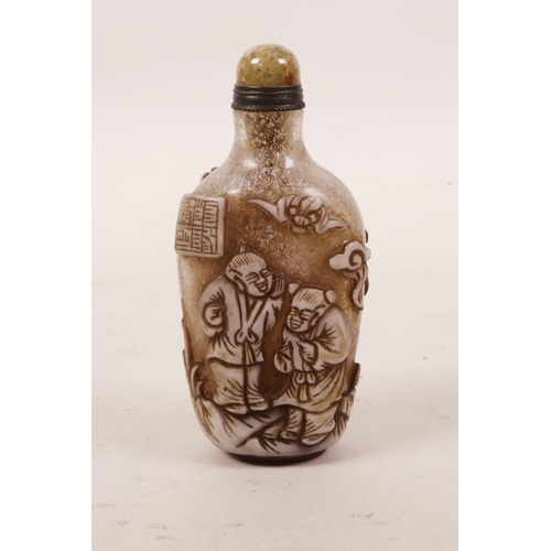 49 - A Peking glass snuff bottle with carved decoration of children playing, 3½