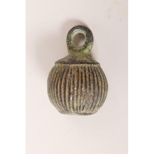 5 - An antique bronze weight with verdigris patina, 2