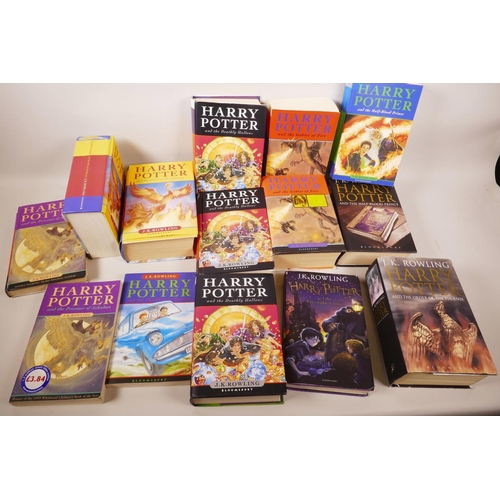 52 - Fourteen volumes of Harry Potter books by J.K. Rowling...