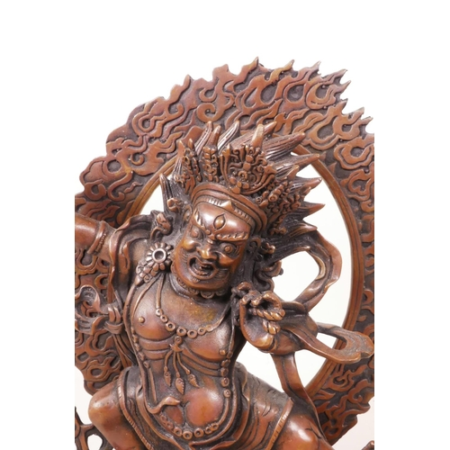 55 - A Sino-Tibetan coppered metal figure of a wrathful deity, impressed double vajra mark to base, 7½