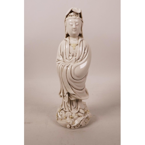 60 - A Chinese blanc de chine figure of Quan Yin, impressed mark verso, 9½