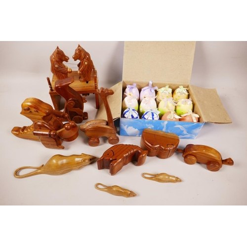 7 - A quantity of animated wooden toys, two puzzle trinket boxes and a box of painted eggs with surprise...