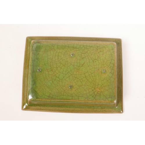 8 - A Chinese green glazed pottery trinket dish with a ribbed interior and raised lotus flower decoratio...