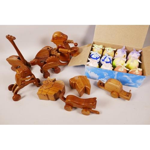 9 - A quantity of animated wooden toys, two puzzle trinket boxes and a box of painted eggs with surprise...