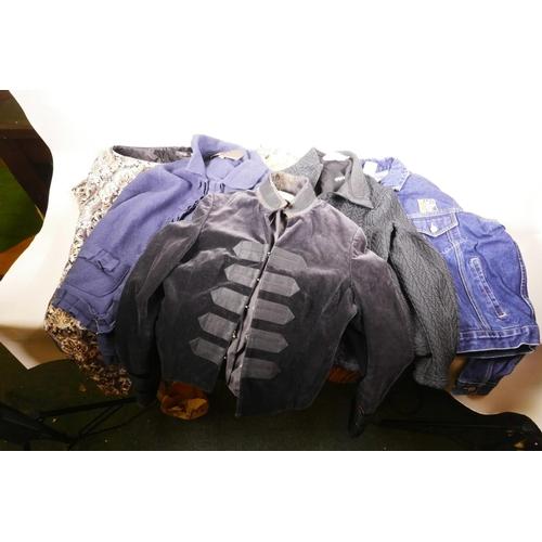 12 - A quantity of ladies' designer clothing including a Karen Millen velvet jacket...